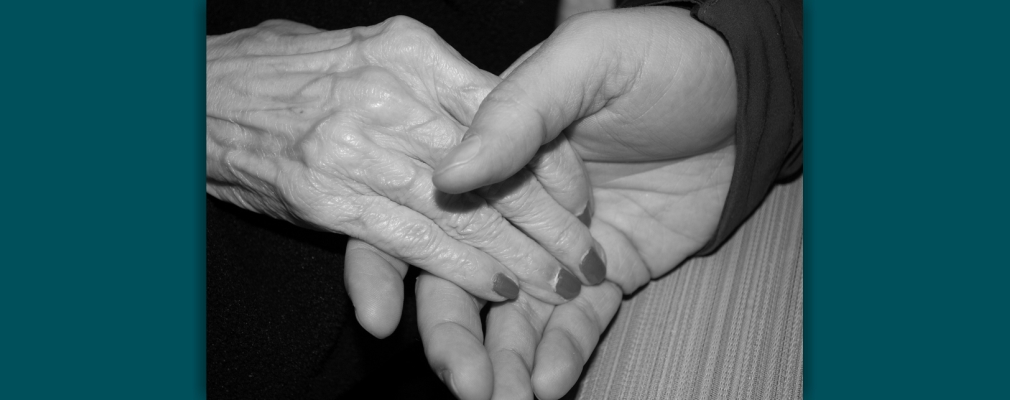 Image of elderly people holding hands